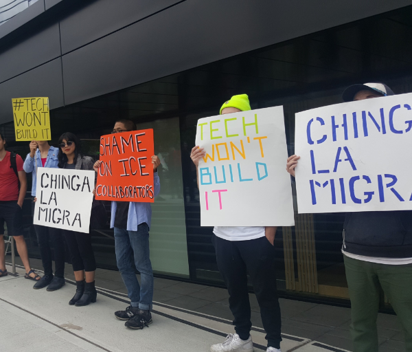 Workers in front of Tableau demand