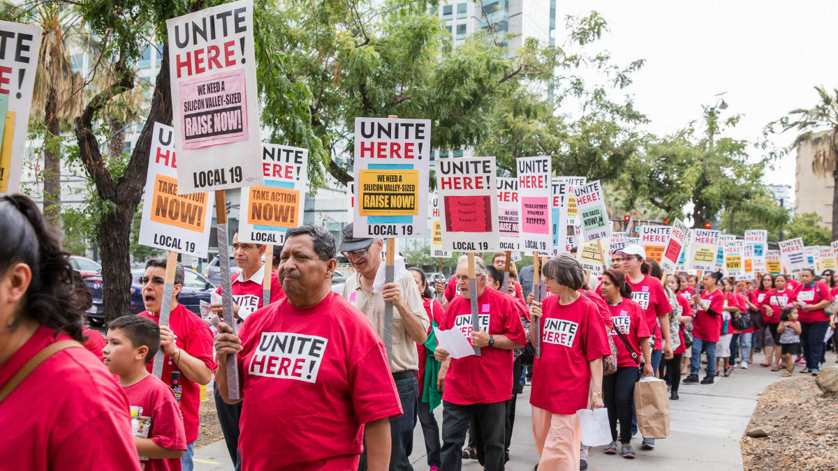 Members of Unite Here Local 19 demonstrate for a raise